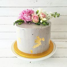 Concrete grey buttercream birthday cake with gold leaf and fresh flowers by Blossom & Crumb