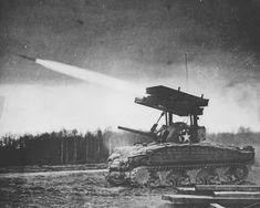 M4 Sherman tank firing its T34 Calliope rocket launcher. Germany, 1945.
