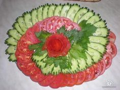 Veggie tray of tomatoes and cucumbers