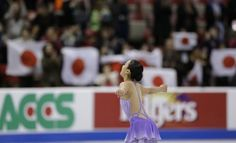 Mao Asada of Japan acknowledges the crowd after competing during the ladies short program at the Skate America figure skating competition in...