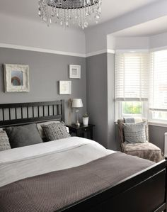 Different tones of grey give this bedroom a unique and interesting look. Continue a colour theme throughout soft furnishings for a boutique-hotel feel: