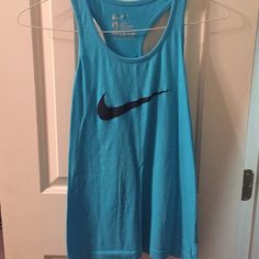 Nike tank top Blue nike tank top! Perfect for working out or hanging out in! Really comfortable and its slim fit Nike Tops Tank Tops
