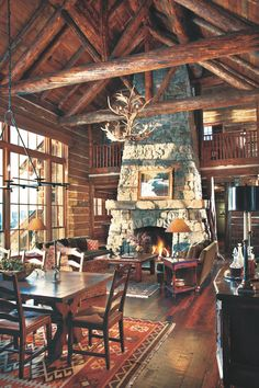 A vaulted ceiling exposes the entire beauty of this custom fireplace. Mountain Cabin Decor, Mountain Living, Mountain Cabins, Mountain Homes, Custom Fireplace, Home Fireplace, Fireplace Hearth, Cabin Style Homes, Log Homes