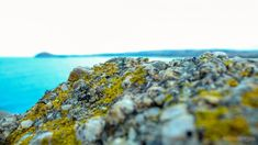 iPhone X Wallpaper Beach coast blue ocean rock closeup 1366768 Wallpaper HD 4k Download free