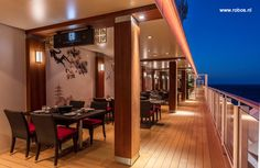 The Promenade on Genting Dream. You can do your own cooking on the table! Project by Robos Contract Furniture #cruise #cruisefurniture #roboscontractfurniture #starcruises #gentingdream