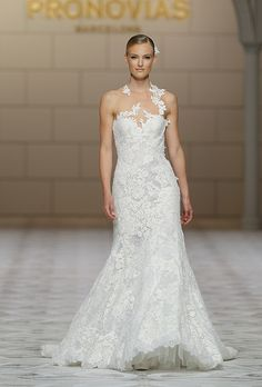 """Brides.com: . """"Carezza"""" sleeveless lace and guipure mermaid wedding dress with a sweetheart neckline and illusion lace appliqués, Pronovias"""