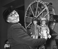 kathe kruse showing two of her dolls in 1955