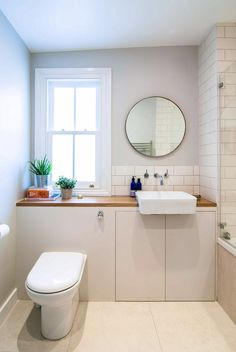 Light filled bathroom with a minimal colour palette with its central features being the round mirror and extended sink. Bathroom Interior Design, Kitchen Interior, Open Plan Kitchen Living Room, Fantasy House, Attic Rooms, Scandi Style, House Extensions, Amazing Bathrooms, Small Bathroom