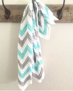 Single Crochet in back loop only to get these ridges.     The colors for this blanket are heavenly. Perfect for a new baby boy or girl. I ...