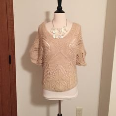 Forever 21 crochet sweater Worn a couple times. Really cute when worn off the shoulder! One of the holes on shoulder is getting slightly bigger as shown in last photo - can easily be fixed. Necklace sold separate Forever 21 Sweaters V-Necks