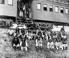 Chiricahua Apache prisoners, including Geronimo (first row, third from right), seated on an   embankment outside their railroad car, Arizona.   Photographed by J. McDonald, 1886.