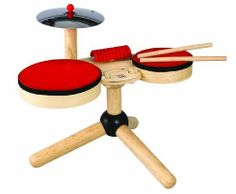 """PlanToys Musical Band by Plan Toys. $44.26. Comes with two sizes of drums with sturdy Latex drum heads. Attached guiro makes a pleasant rhythmic wooden sound. Made from all-natural organic recycled rubberwood and water-based dyes. Attached metal cymbal makes a great striking sound. From the Manufacturer                Plan Toy Musical Band is a complete drum set for preschoolers. It comes with two drums, a metal cymbal, guiro and two drumsticks. This set stands over 13"""" tall..."""