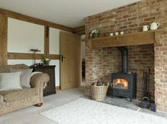 Border Oak - Inglenook fireplace with woodburner and oak lintel.