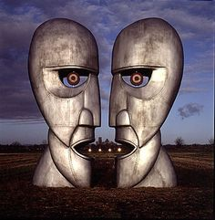 Pink Floyd - The Division Bell: Two huge metal statues talking to each other. Hm. This is the final Pink Floyd studio album, and it's rather easy to overlook. This is a real photograph, by the way. They really did build and erect these statues.