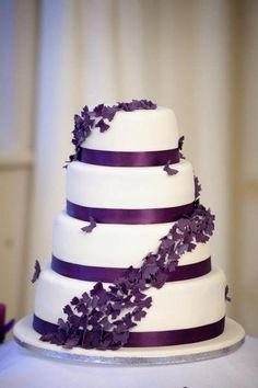 http://thepinkcakebox.co.uk - purple butterflies wedding cake