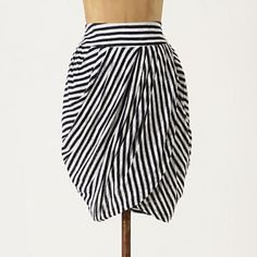 Anthropologie Striped Skirt Super flattering tulip-shaped skirt from Anthropologie with navy and white stripes. Cotton lining with back hidden zipper. Original description: Any way you look at it, Lil's tulip-shaped linen skirt is sure to add some sway to your strut. Anthropologie Skirts