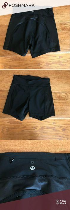 Lululemon black workout shorts Lululemon black workout shorts, size 2, zipper in the back. Mint condition. lululemon athletica Shorts