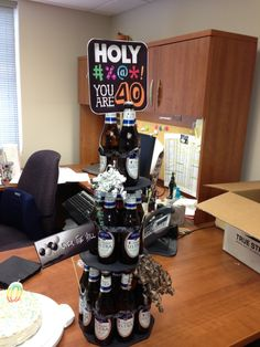 Our version of tiered beer bottle cake for Jason's 40th birthday - excuse my messy desk