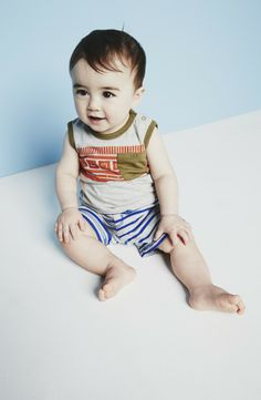 Too cute! Sleeveless bodysuit and strip knit shorts.