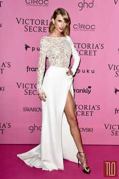 Taylor Swift at the 2014 Victoria's Secret Fashion Show in Zuhair Murad couture long-sleeve gown