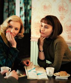 Carol Aird and Therese Belivet: A 1950's housewife in the midst of a divorce develops a secret affair with an impressionable young store clerk. (Carol, 2015, Todd Haynes. Portrayed by Cate Blanchett and Rooney Mara)