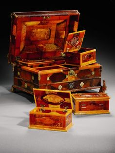 Jewelry boxes made of natural amber from the Baltic Sea.  They were crafted in 1734 to celebrate the marriage of England's King William (of Orange) and Queen Mary.