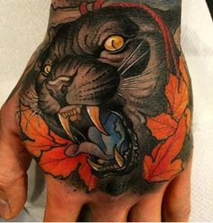 Hakan Havermark nailed this amazing piece. #Inked #inkedmag #tattoo #exotic #cat #hand #idea