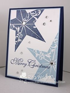 Christmas Star ---Stamps: Christmas Star, Greetings of the Season Ink: Bashful blue, Night of Navy, Versamark Paper: Night of Navy, Bashful Blue, Whisper White Accessories: Iridescent Ice embossing powder, Basic Rhinestones Tools: Heat Tool