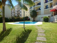 Plaza Apartment Cani�o Set in Cani?o, this apartment features a garden with an outdoor pool. The property is 2 km from Reis Magos Beach and free private parking is offered. Free WiFi is provided .  There is a seating area and a kitchen as well as a private bathroom.