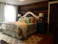 My new master bedroom! Barn wood walls, teal night stands, chevron pattern pillows