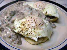 Buttermilk biscuits, sausage, eggs over easy, & sausage gravy -- classic Southern breakfast that'll stick with ya  :-)   #South #recipe