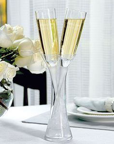 Stunning and unusual wedding toast glass for the special couple.  Uber classy :-)