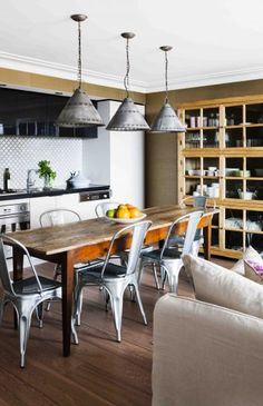 vintage style eat-in kitchen with fantastic metal pendant lights