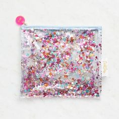 This confetti pouch from Packed Party adds a little sparkle everywhere you go! Clear pouch is double lined and filled with confetti!<br><br> Size - 8 x 8.5