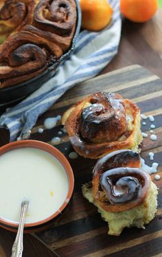 The fluffiest and perfectly sweet Buttermilk Clementine Cinnamon Rolls. Make a batch for visitng guests this holiday season, it's the perfect way to fill the air with a Winter citrus and buttery smell.   - notjustbaked.com