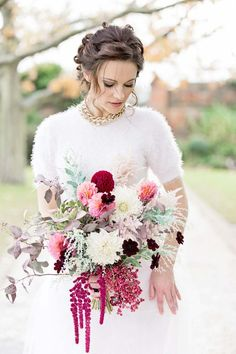 Loving the top of this wedding gown for a winter bride. 'Hollywood Glam' A Sophisticated, Feminine Bridal Shoot With Bold Burgundy!