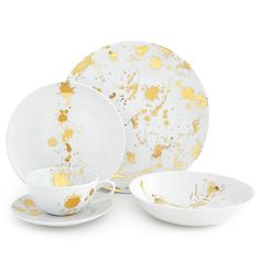Artfully Irreverent.Chic and classique porcelain dinnerware in a generous scale and friendly coupe shape with a surprising splatter of solid gold. With its