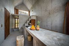 Casa Tiny Concrete Surf House in Mexico. Tucked away up in the hills from the busy surf town of Puerto Escondido is a minimalist and tiny home made entirely of concrete.