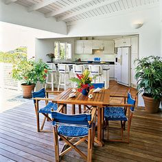White and lightly lit open air kitchen surrounded by three walls that face an wood deck: Because a ceiling protects the wood cabinets and interior-grade appliances from the weather, this fully loaded kitchen has both indoor style and outdoor ambiance. Indoor Outdoor Kitchen, Outdoor Kitchen Design, Outdoor Dining, Kitchen Decor, Outdoor Kitchens, Kitchen Ideas, Outdoor Seating, Outdoor Ideas, Outdoor Living Rooms