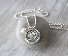Personalized Wax Seal Initial Necklace - Personalized Womens Initial Charm - Wax Seal Necklace - Sterling Silver Monogram Necklace by PrairieCoastArt on Etsy https://www.etsy.com/listing/100499560/personalized-wax-seal-initial-necklace