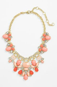 Twinkling crystals make this peach and pink bib necklace perfect for prom.