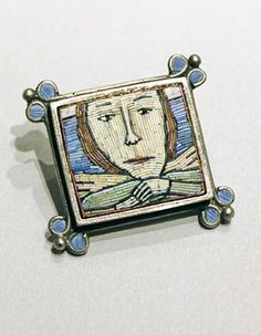 Polymer clay mosaic brooch by Cynthia Toops. Metalwork by Chuck Domitrovich.