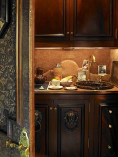Guest kitchenette in back hall of NY apartment of Howard Slatkin.  From his book FIFTH AVENUE STYLE. Photo by Tria Giovan