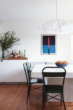 Kitchen dining area with a white concrete table and bench seating
