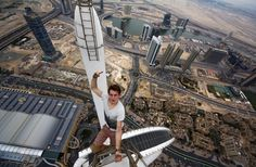 A RUSSIAN daredevil has captured a vertigo-inducing selfie - while standing on top of a Dubai skyscraper. Nineteen-year-old Alexander Remnev scaled the Princess Tower - the worlds tallest residential building at 1,350ft - before getting his camera out to take these stomach-churning pictures. Alexander, who was on holiday in Dubai with friends, says they climbed a number of the citys towering skyline during the course of their stay. news, dubai, daredevil, selfie, vertigo, view dubaigallery