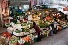 Fruit and vegetables on sale in old Chinese Soho food market in Graham Street, Central Hong Kong, China - Photo by Tim Graham