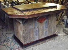 Barn wood tiki bar trimmed out with walnut - love the colors...