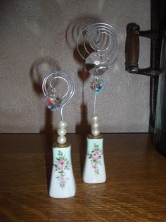 Salt and pepper photo holder SHABBY CHIC. $20.00, via Etsy.  How clever is that to use S shakers?!