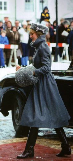 Princess Diana arrives to the Gloucester Cathedral for a Christmas Service. She wears a Cossack coat with a fur lamb collar, matching hat and muff – a Russian-style ensemble by Bellville Sassoon. 22 December 1981.