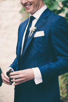 blue checked suit for the groom, photo by Lisa Poggi http://ruffledblog.com/tuscany-destination-wedding #grooms #suits